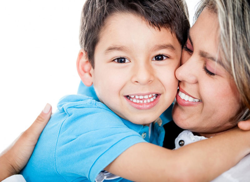 Mom and child embracing with big smiles